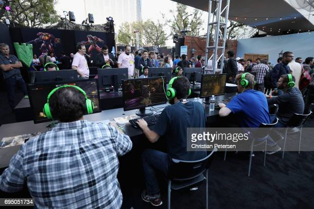 Gamers compete in 'Quake' as they attend the Bethesda E3 conference at the LA Center Studios on June 11 2017 in Los Angeles California The E3 Game...