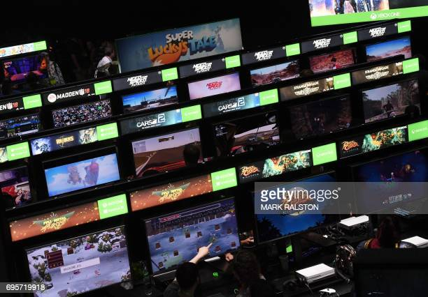 Gamers crowd the Microsoft Xbox One exhibit at the Los Angeles Convention center on day one of E3 2017 the three day Electronic Entertainment Expo...