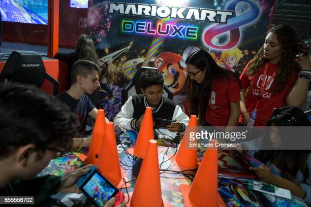 Gamers play Mario Kart 8 Deluxe at the Nintendo stand during the Milan Games Week 2017 on September 29 2017 in Milan Italy The Milan Games Week is...