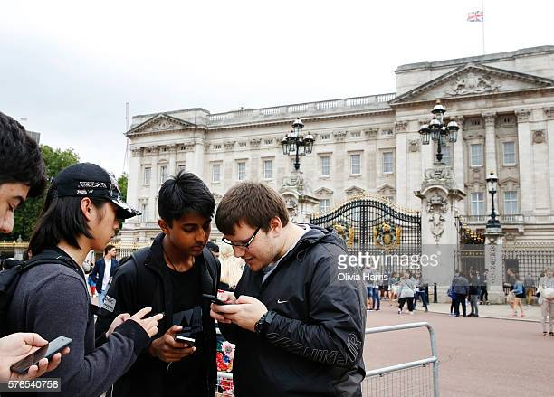 Gamers play Pokemon Go a mobile game that has become a global phenomenon the day after it's UK release on July 15 2016 outside Buckingham Palace...