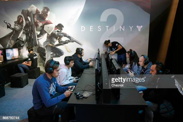Gamers play the video game 'Destiny 2' developed by Bungie Studios and published by Activision during the 'Paris Games Week' on October 31 2017 in...