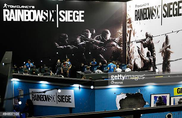 Gamers play the video game Tom Clancy's Rainbow Six Siege developed by Ubisoft at Paris Games Week a trade fair for video games on October 29 2015 in...