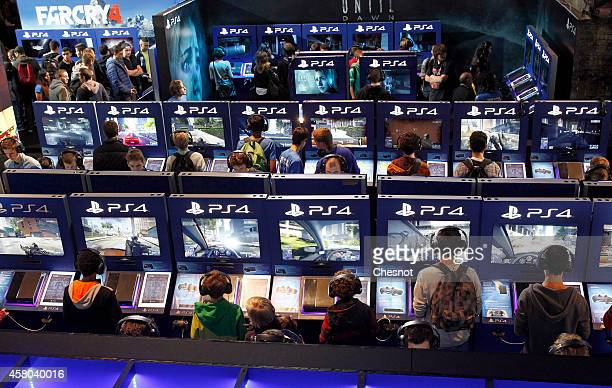 Gamers play video games with the PS4 consoles of Playstation during the International Games Week on October 29 2014 in Paris France International...