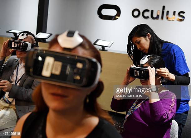 Gamers test a new Virtual Reality game headset at the Oculus display on the second day of the Electronic Entertainment Expo known as E3 at the...