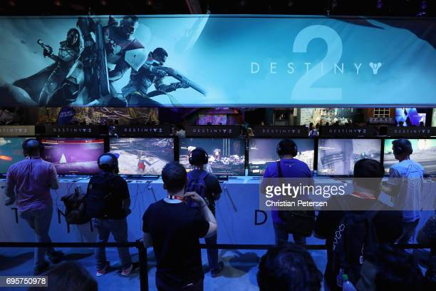 Gamers test 'Destiny 2' at the Sony PlayStation exhibit during the Electronic Entertainment Expo E3 at the Los Angeles Convention Center on June 13...