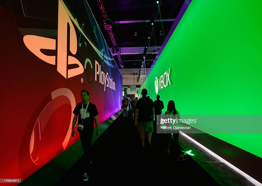 Gamers walk in between Sony Playstation and Ebox booths during the Electronics Expo 2013 at the Los Angeles Convention Center on June 11, 2013 in Los Angeles, California. Thousands are expected to attend the annual three-day convention to see the latest games and announcements from the gaming industry.