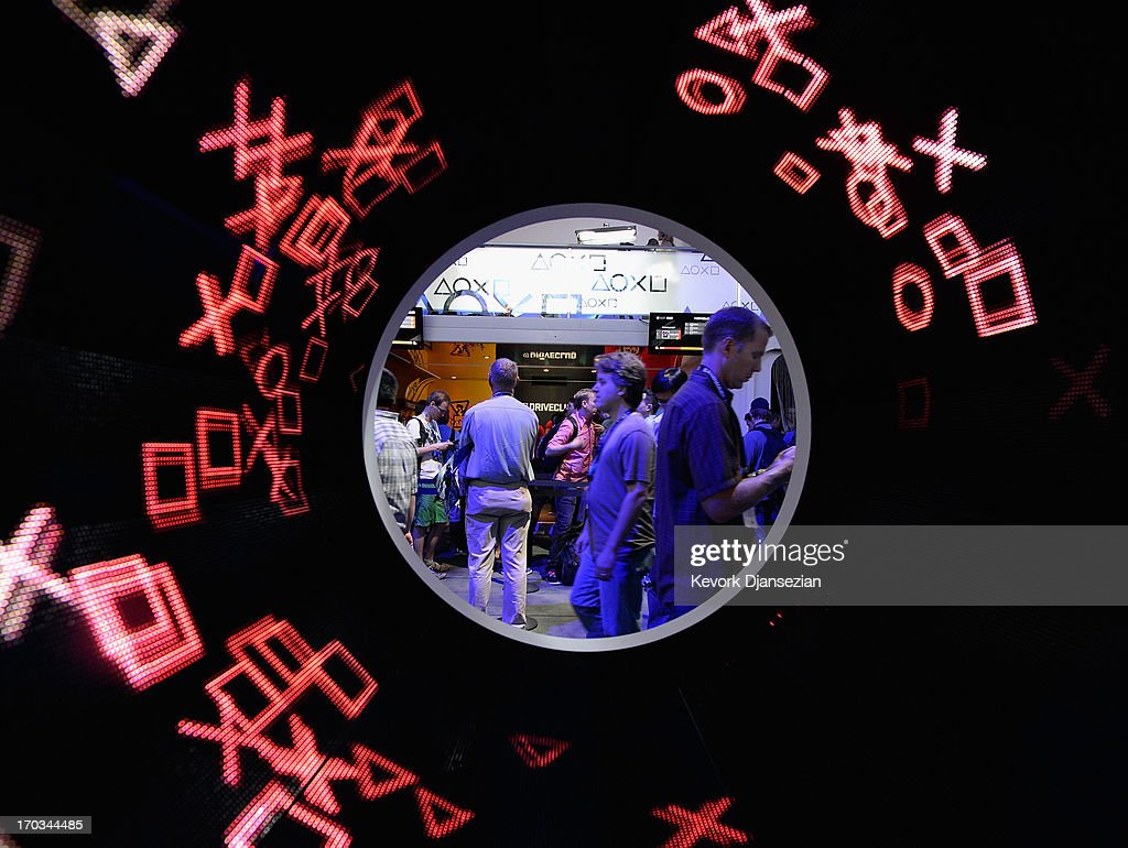 Gamers walk in the Sony Playstation booth durng the Electronics Expo 2013 booth at the Los Angeles Convention Center on June 11, 2013 in Los Angeles, California. Thousands are expected to attend the annual three-day convention to see the latest games and announcements from the gaming industry.