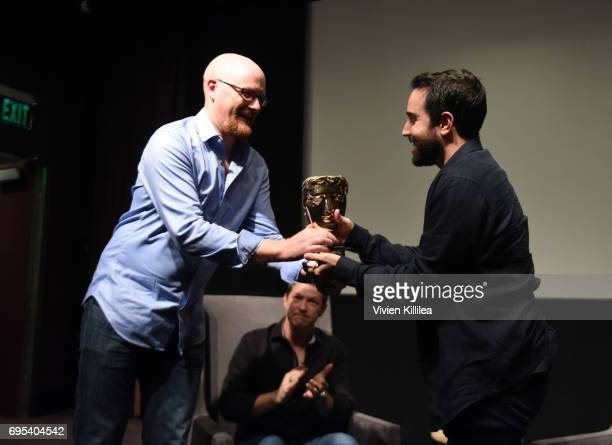 Games Committee Chair Nick ButtonBrown presents cofounder and coCEO of Riot Games Brandon Beck with an award at BAFTA Honours Riot Games with Special...
