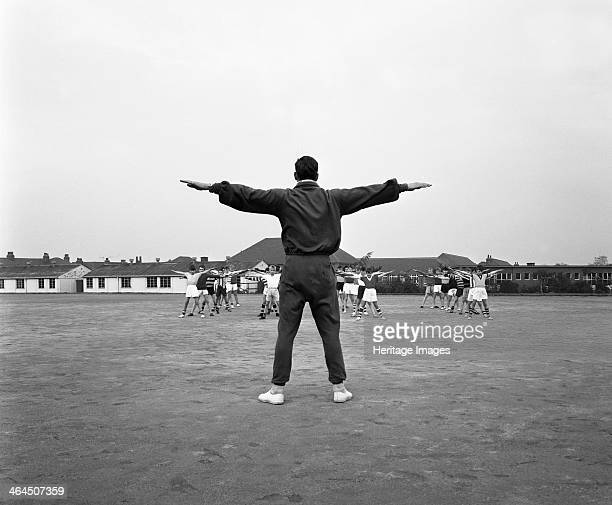 Games master taking a gym class Airedale school Castleford West Yorkshire 1962