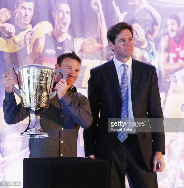AFL games record holder Brent Harvey and AFL CEO Gillon McLachlan pose with the AFL Premiership Cup during the 2017 AFL Finals Launch at Melbourne...