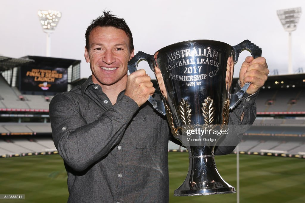 AFL games record holder Brent Harvey poses with the AFL Premiership Cup during the 2017 AFL Finals Launch at Melbourne Cricket Ground on September 4, 2017 in Melbourne, Australia. Harvey is the AFL Premiership Cup Ambassador.