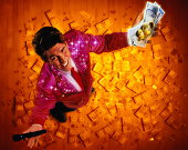 Gameshow host surrounded by cash, overhead view (Digital Composite)