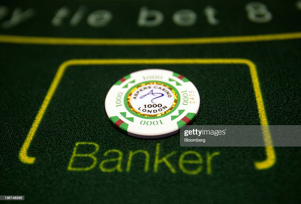 A gaming chip valued at 1000 British pounds sits on a card table at the Aspers Casino at Westfield Stratford City Mall in London, U.K. on Wednesday, Jan. 11, 2012. Westfield Group agreed to sell its 75 percent interest in the Broadmarsh shopping center to Capital Shopping Centres for 55 million pounds. Photographer: Simon Dawson/Bloomberg via Getty Images