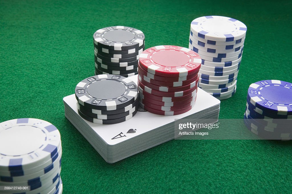 Gaming chips and deck of cards : Stock Photo