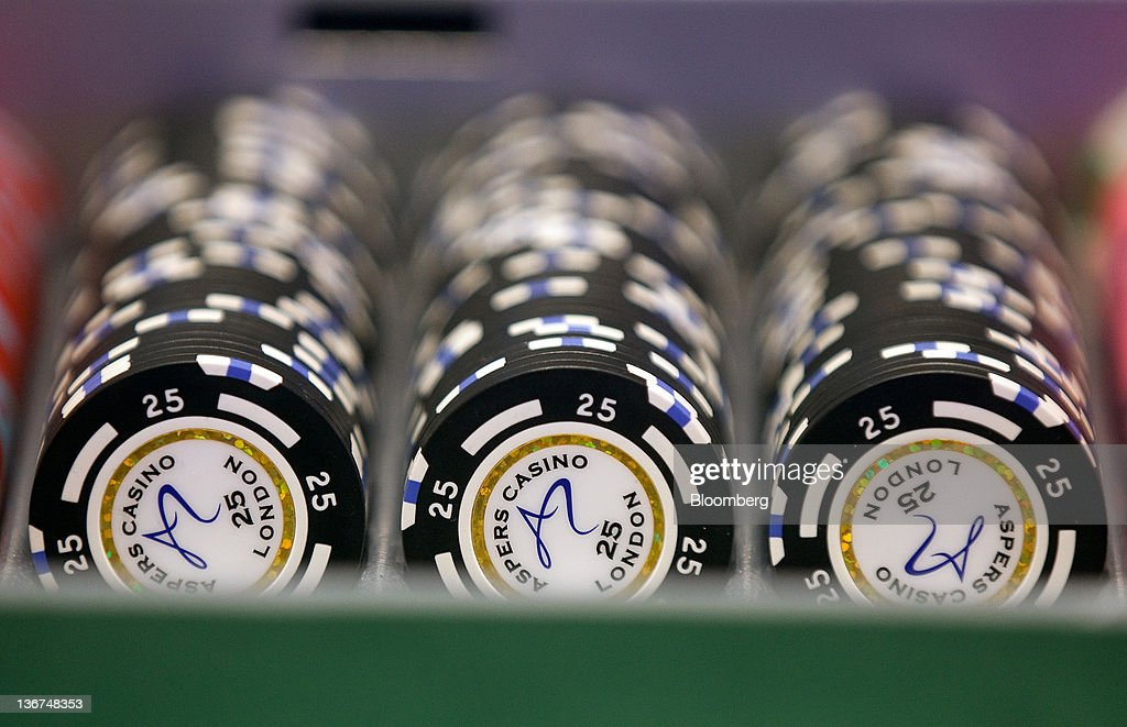 Gaming chips sit in a rack on a card table at the Aspers Casino at Westfield Stratford City Mall in London, U.K. on Wednesday, Jan. 11, 2012. Westfield Group agreed to sell its 75 percent interest in the Broadmarsh shopping center to Capital Shopping Centres for 55 million pounds. Photographer: Simon Dawson/Bloomberg via Getty Images