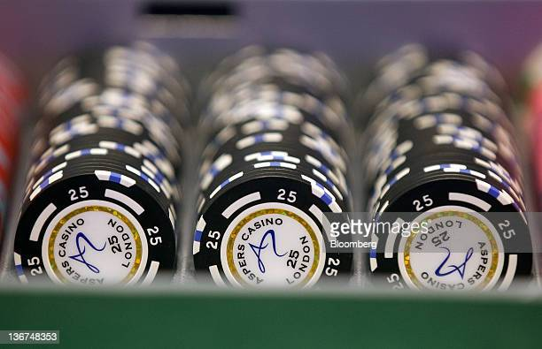Gaming chips sit in a rack on a card table at the Aspers Casino at Westfield Stratford City Mall in London UK on Wednesday Jan 11 2012 Westfield...