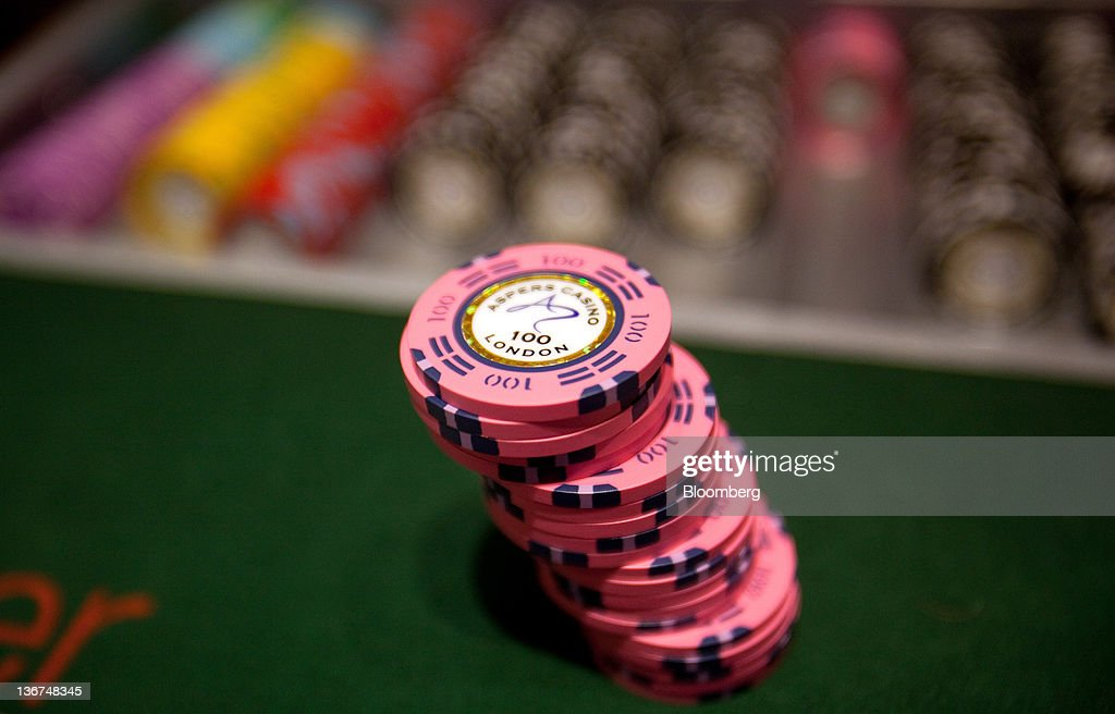 Gaming chips sit on a card table at Aspers Casino at Westfield Stratford City Mall in London, U.K. on Wednesday, Jan. 11, 2012. Westfield Group agreed to sell its 75 percent interest in the Broadmarsh shopping center to Capital Shopping Centres for 55 million pounds. Photographer: Simon Dawson/Bloomberg via Getty Images