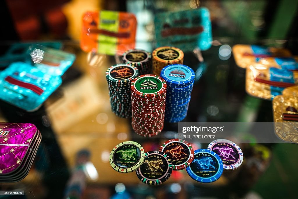 Gaming coins are displayed at a booth of the Global Gaming Expo Asia in the worlds biggest gambling hub of Macau on May 20 2014 The threeday fair of...