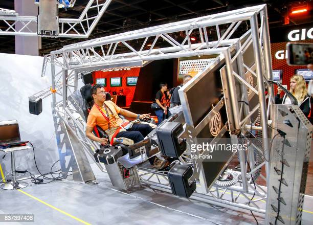 A gaming enthusiast play a video game at the Gamescom 2017 gaming trade fair on August 22 2017 in Cologne Germany Gamescom is the world's largest...