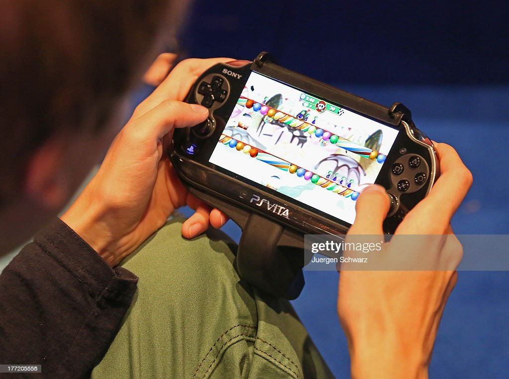 A gaming enthusiast tries out a Sony Playstation Vita game at the Gamescom 2013 gaming trade air on August 22, 2013 in Cologne, Germany. Gamescom is the world's largest trade fair for digital gaming and will be open to the public from August 22-25.