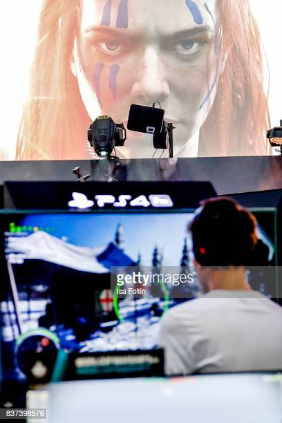 A gaming enthusiast try out a virtual reality game at the Gamescom 2017 gaming trade fair on August 22 2017 in Cologne Germany Gamescom is the...