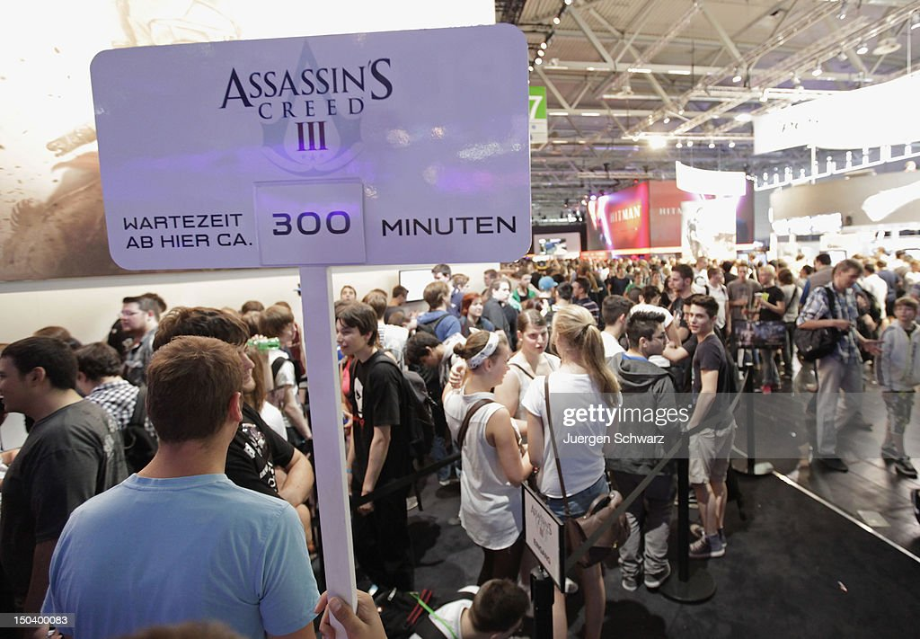 Gaming enthusiasts line up with a waiting time of five houres before playing Assassin's Creed at the Gamescom 2012 gaming trade fair on August 16, 2012 in Cologne, Germany. Gamescom is Europe's largest gaming expo with 600 international developers exhibiting their latest products. Around 250,000 visitors are expected to attend the four-day event being held between August 15-19.