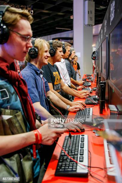 Gaming enthusiasts play a video game at the Gamescom 2017 gaming trade fair on August 22 2017 in Cologne Germany Gamescom is the world's largest...