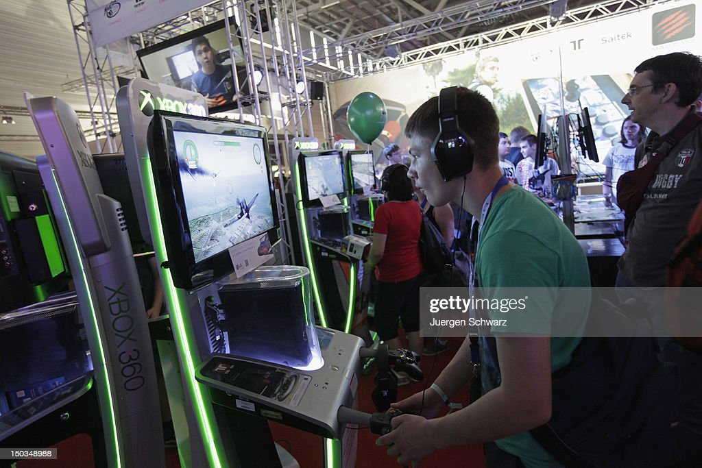 Gaming enthusiasts play Birds of Steel on a xbox360 at the Gamescom 2012 gaming trade fair on August 16, 2012 in Cologne, Germany. Gamescom is Europe's largest gaming expo with 600 international developers exhibiting their latest products. Around 250,000 visitors are expected to attend the four-day event being held between August 15-19.