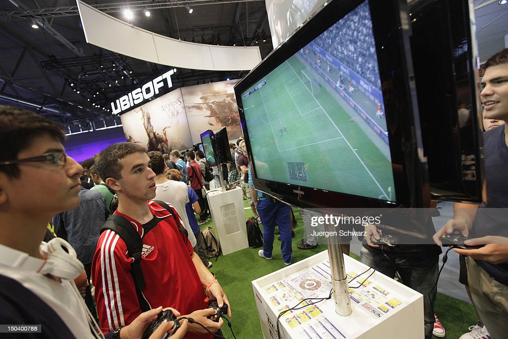 Gaming enthusiasts play PES 2012 soccer game at the Gamescom 2012 gaming trade fair on August 16, 2012 in Cologne, Germany. Gamescom is Europe's largest gaming expo with 600 international developers exhibiting their latest products. Around 250,000 visitors are expected to attend the four-day event being held between August 15-19.