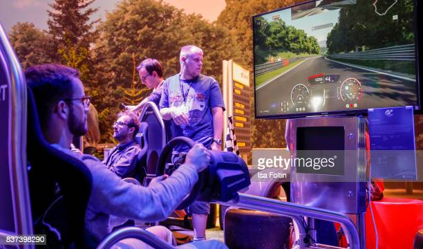 A gaming enthusiasts tries out a racing game at the Gamescom 2017 gaming trade fair on August 22 2017 in Cologne Germany Gamescom is the world's...