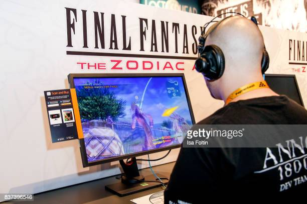 A gaming enthusiasts tries out the Final Fantasy The Zodiac game at the Gamescom 2017 gaming trade fair on August 22 2017 in Cologne Germany Gamescom...