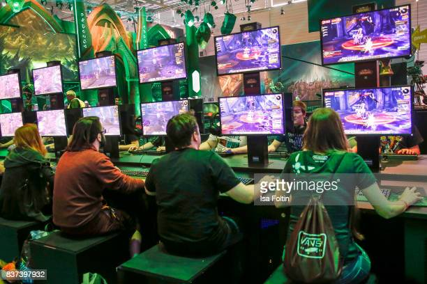Gaming enthusiasts try out a game at the Gamescom 2017 gaming trade fair on August 22 2017 in Cologne Germany Gamescom is the world's largest digital...