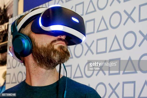 A gaming enthusiasts try out a virtual reality game at the Gamescom 2017 gaming trade fair on August 22 2017 in Cologne Germany Gamescom is the...