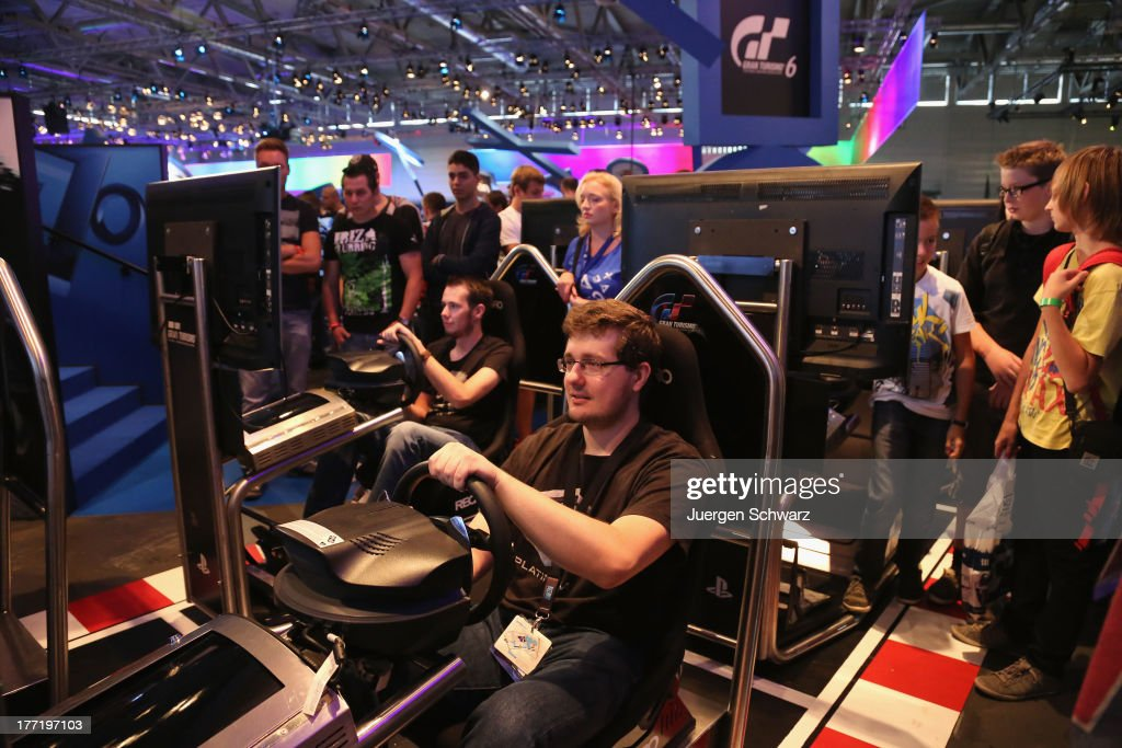 Gaming enthusiasts try out games on the new Sony Playstation 4 at the Gamescom 2013 gaming trade air on August 22, 2013 in Cologne, Germany. Gamescom is the world's largest trade fair for digital gaming and will be open to the public from August 22-25.