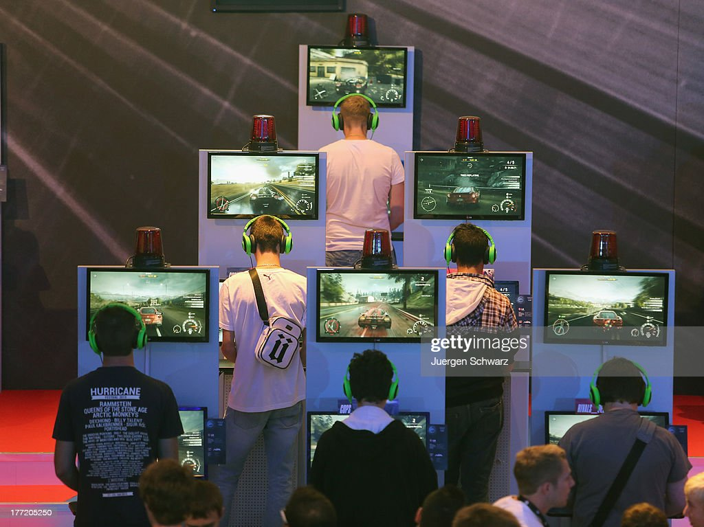 Gaming enthusiasts try out Need for Speed game on the new XBOX at the Gamescom 2013 gaming trade air on August 22, 2013 in Cologne, Germany. Gamescom is the world's largest trade fair for digital gaming and will be open to the public from August 22-25.