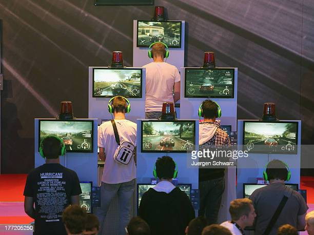 Gaming enthusiasts try out Need for Speed game on the new XBOX at the Gamescom 2013 gaming trade air on August 22 2013 in Cologne Germany Gamescom is...
