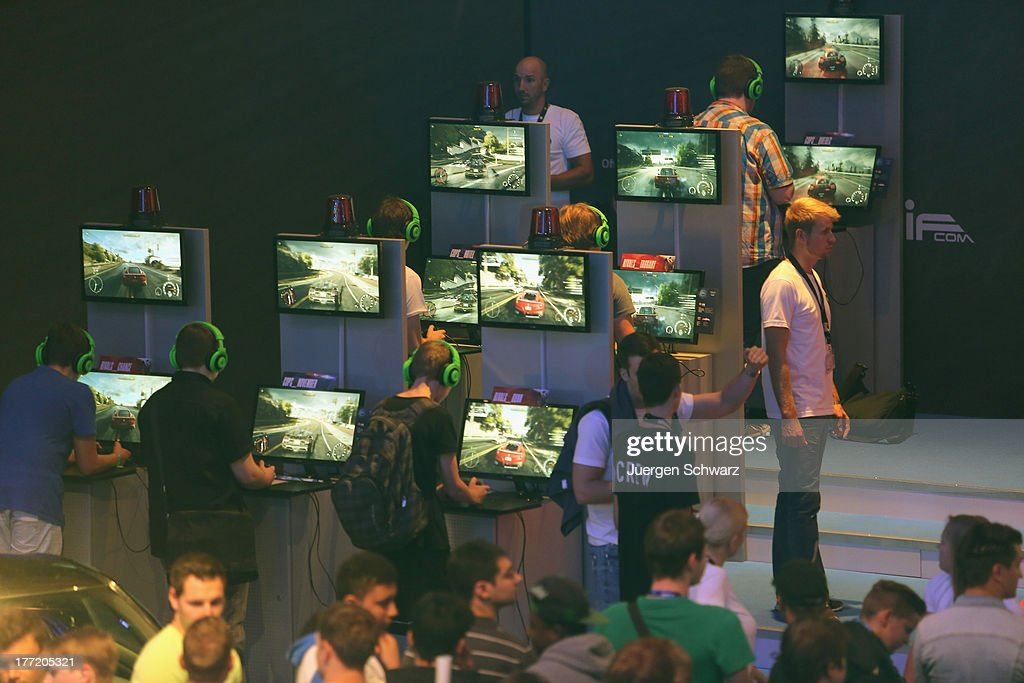 Gaming enthusiasts try out the 'FIFA 14' game on the new XBOX at the Gamescom 2013 gaming trade air on August 22, 2013 in Cologne, Germany. Gamescom is the world's largest trade fair for digital gaming and will be open to the public from August 22-25.