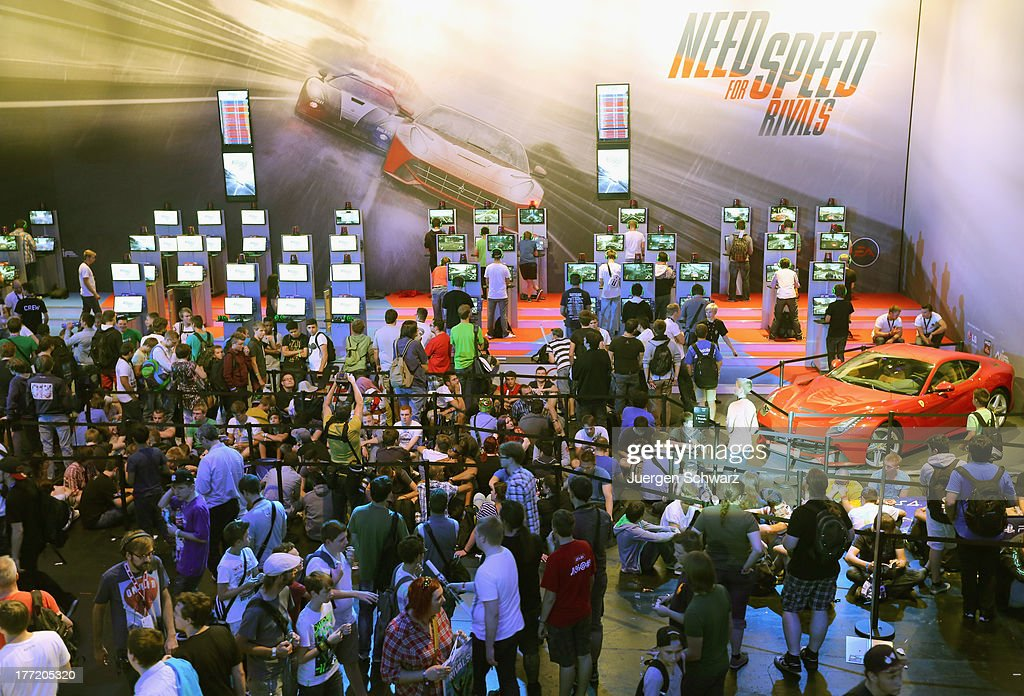 Gaming enthusiasts try out the 'Need for Speed Rivals' game on the new XBOX at the Gamescom 2013 gaming trade air on August 22, 2013 in Cologne, Germany. Gamescom is the world's largest trade fair for digital gaming and will be open to the public from August 22-25.