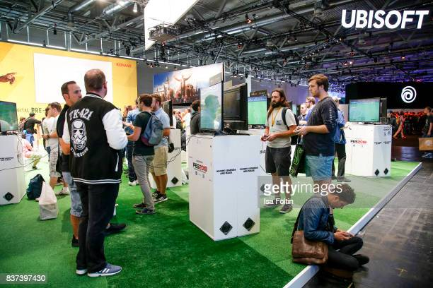 Gaming enthusiasts visit the Ubisoft stand at the Gamescom 2017 gaming trade fair on August 22 2017 in Cologne Germany Gamescom is the world's...