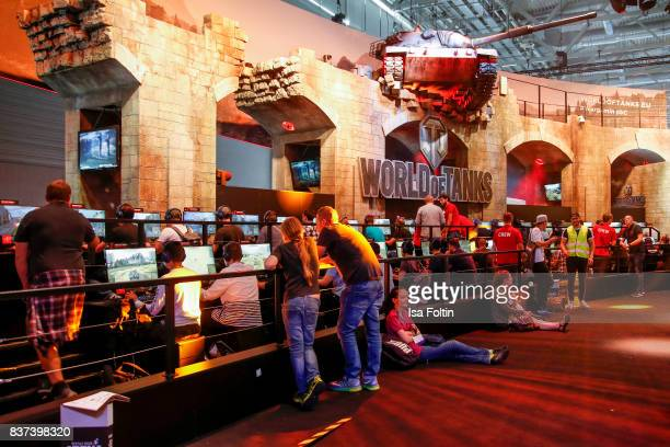 Gaming enthusiasts visit the World of Tanks stand at the Gamescom 2017 gaming trade fair on August 22 2017 in Cologne Germany Gamescom is the world's...