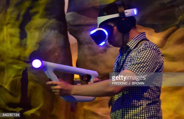 A gaming fan plays 'Farpoint' while wearing Playstation VR Morpheus during the 2016 Electronic Entertainment Expo annual video game conference and...