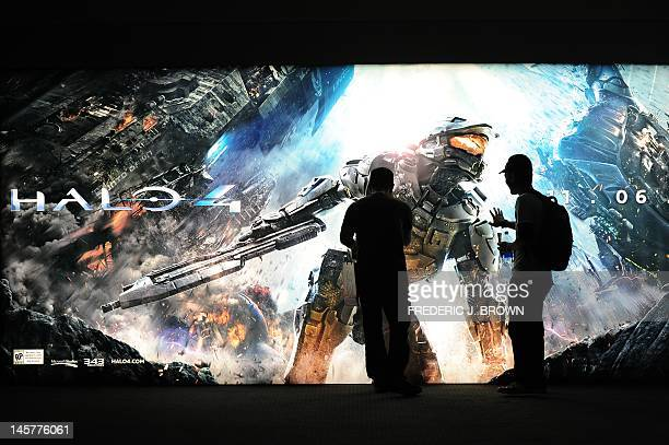 A gaming fan touches the advertising disply for Halo 4 at the Nintendo section on the opening day of the E3 videogame conference in Los Angeles on...