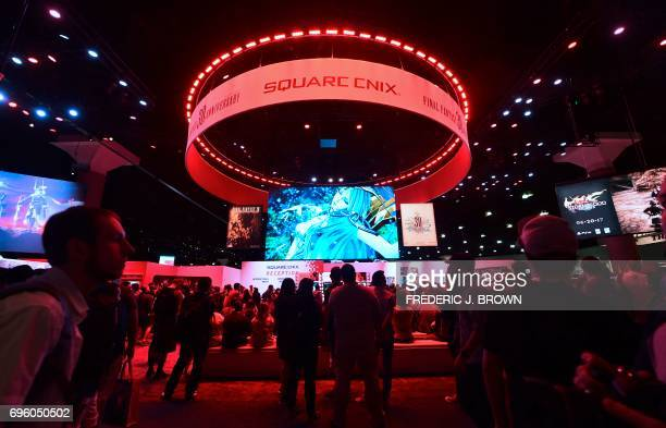 Gaming fans play 'Dissidia Final Fantasy' from Square Enix seen on big screen on day two of the three day Electronic Entertainment Expo at the Los...