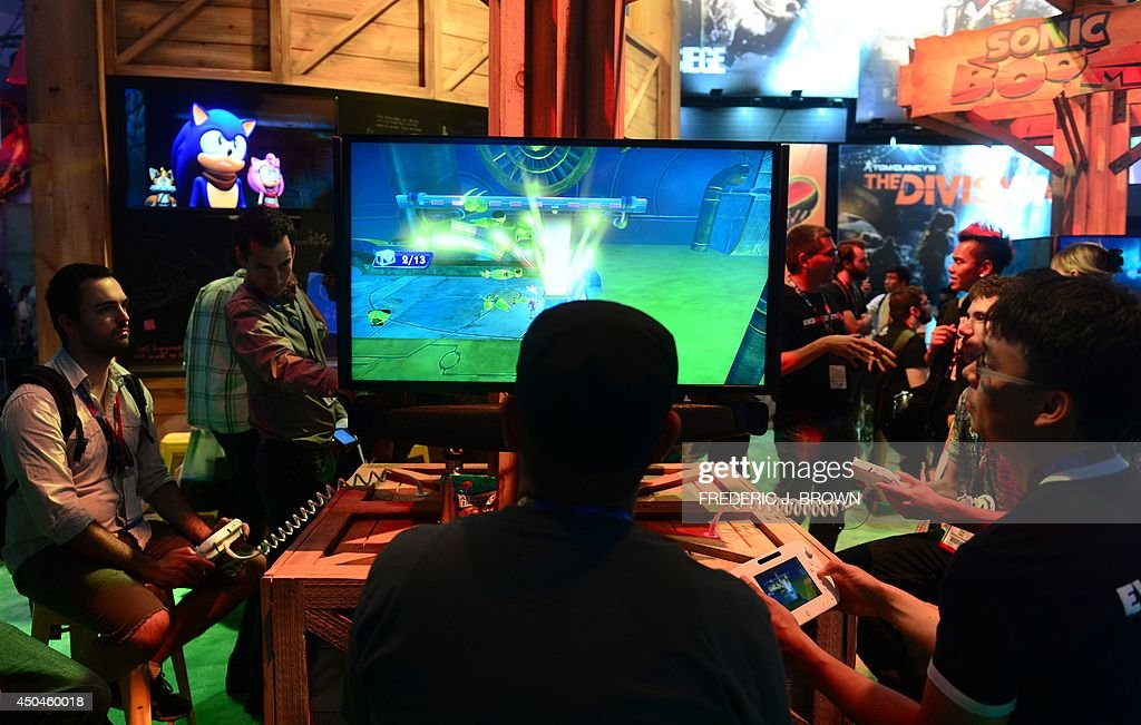Gaming fans play 'Sonic Boom' for Wii on day two at the annual E3 video game extravaganza in Los Angeles, California on June 11, 2014, where new consoles from Microsoft and Sony are girding to battle for the throne of the video game industry. AFP PHOTO/Frederic J. BROWN