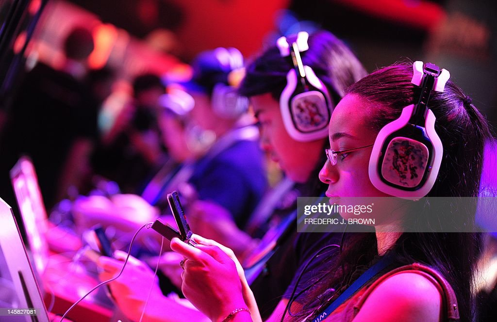 Gaming fans sample new titles and devices on the second day of the E3 videogame extravaganza in Los Angeles on June 6, 2012 in California, where sequels to blockbuster console titles and play on smartphones or tablets are being showcased with Times Square-like glitz at the annual event. Paramount Pictures and game publisher NAMCO BANDAI Games America Inc. announced on June 5 that Chris Pine and Zachary Quinto, the actors who played Captain James T. Kirk and Spock in the 2009 film reboot of 'Star Trek' , will reprise their roles from the film directed by J.J. Abrams and give voice to those characters in a videogame based on the beloved science fiction franchise. AFP PHOTO/Frederic J. BROWN