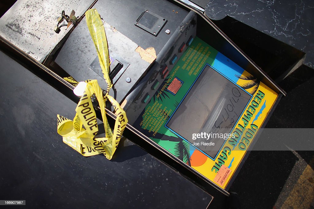 A gaming machine is seen before it is destroyed as the City of Miami begins a crack down on business owners with illegal gambling machines commonly referred to as 'maquinitas' in Spanish on April 18, 2013 in Miami, Florida. The City started the operation after the State of Florida recently passed a bill that included among other items, prohibiting electronic gambling devices for charitable promotions as well as updating the definition of slot machines and banning machines intended to simulate casino games and slot machines.