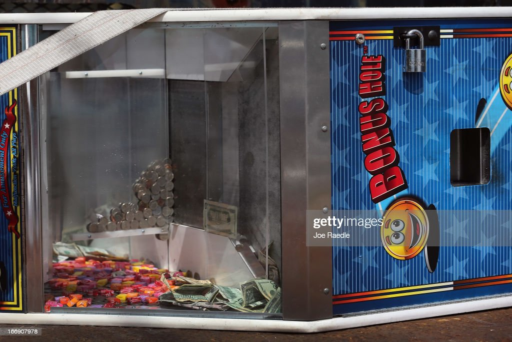 A gaming machine is seen on the back of a police truck after it was confiscated as the City of Miami begins a crack down on business owners with illegal gambling machines commonly referred to as 'maquinitas' in Spanish on April 18, 2013 in Miami, Florida. The City started the operation after the State of Florida recently passed a bill that included among other items, prohibiting electronic gambling devices for charitable promotions as well as updating the definition of slot machines and banning machines intended to simulate casino games and slot machines.