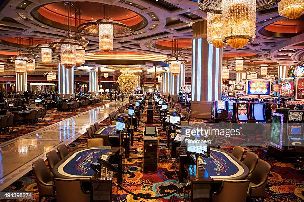 Gaming tables sit on the gaming floor of the casino at the Studio City casino resort developed by Melco Crown Entertainment Ltd ahead of the grand...