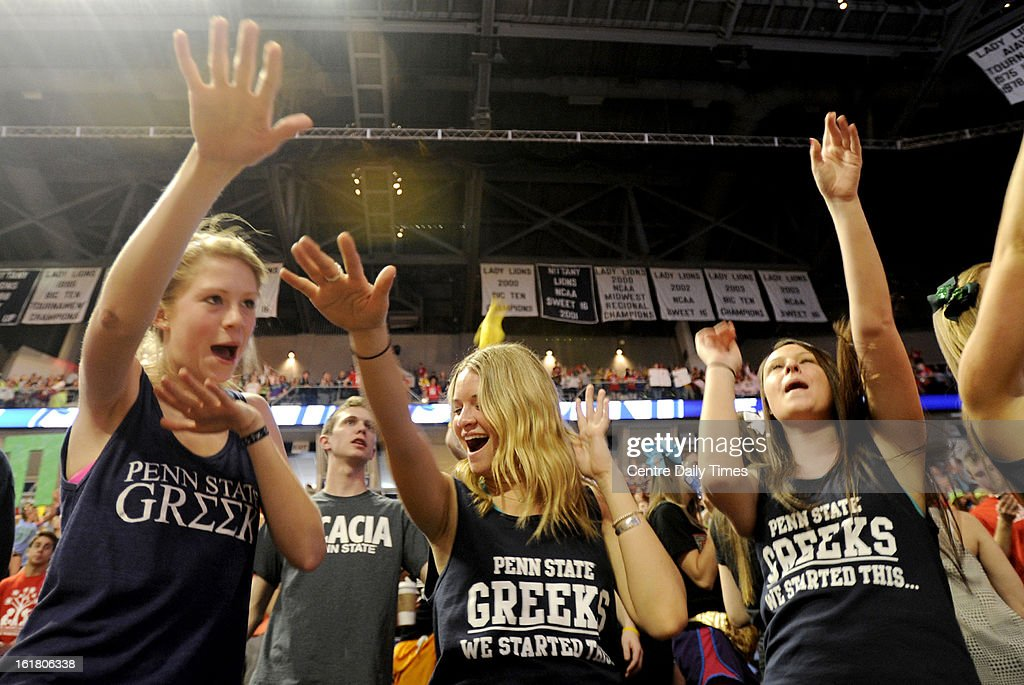 Gamma Phi Beta sisters Lauren Crawfore, Kaitlyn Palocsko and Jenn Oliverie dance to 'Sweet Caroline' during the Penn State IFC/Panhellenic Dance Marathon at the Bryce Events Center in University Park, Pennsylvania, on Saturday, February 16, 2013. Dancers started the 46-hour fundraiser on Friday. The event, known as Thon, raises money to help families that are battling pediatric cancer. Last year's event raised $10 million.