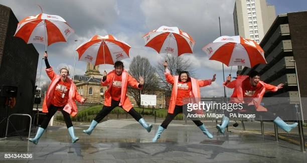 Gampta 'Singing in the Rain ' dancers performing under a rain machine at Cowcaddens Station as part of Glasgow's first Subway festival